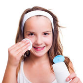 Girl cleaning her face with tonic lotion — Stock Photo