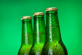 Three wet blank beer bottles — Stock Photo