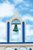 Greek church bell against blue sky — Stock Photo
