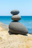 Balanced stacking made of round lava stones — Stock Photo