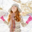 Winter portrait of young woman in fur hat — Stock Photo #54343139