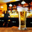 Glass of beer in a bar — Stock Photo #54343471