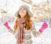 Winter portrait of young woman in fur hat — Stock Photo