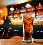 Glass of cola with ice in a bar — Stock Photo