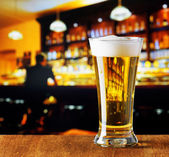 Glass of beer in a bar — Stock Photo