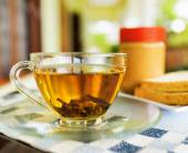 Cup of tea and peanut butter — Stockfoto