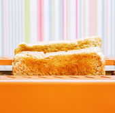 Orange toaster with two slices of bread — Stock Photo
