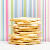 Yellow biscuits on striped background — Stock Photo