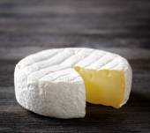 Camembert cheese on a wooden board — Stock Photo