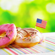 Colorful donuts with flag of USA — Stock Photo #59502567