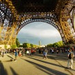 Tourists walking under the Eiffel Tower. Paris. — Stock Photo #62358495