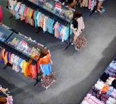 Big sale of fashionable women's clothing and lingerie in store — Zdjęcie stockowe