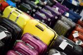 Sale of suitcases of different sizes and colors — Stock Photo