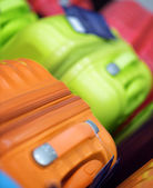New suitcases of different colors — Stock Photo