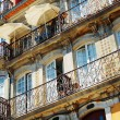 Lace balconies of old houses in Porto, Portugal. — Stock Photo #64054657