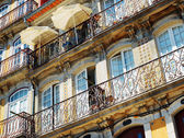 Lace balconies of old houses in Porto, Portugal. — Stock Photo