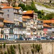 Colorful facades of old houses on embankment of the Douro River — Stock Photo #64112455