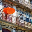 Lace balconies of old houses in Porto, Portugal. — Stock Photo #64117685