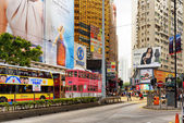 Decker buses and trams on the central streets of Hong Kong — Stock Photo