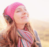 Young woman smiling enjoying music in the spring season — Stock Photo