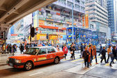 Pedestrians, taxi and double-decker trams on the central streets — Stock Photo