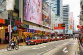 Taxi on the street of city Hong Kong — Stock Photo