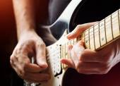 Man playing guitar. Close-up view — Stock Photo