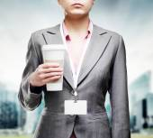 Business woman enjoying the aroma of invigorating coffee on a st — Stock Photo