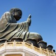 Side view of Tian Tan Buddha on the blue sky background in Hong — Stock Photo #68243657
