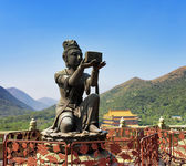 One of Buddhist statues praising and making offerings to the Tia — Stock Photo