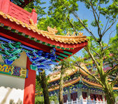 Closeup view of gilded red wooden roofs in traditional Chinese-s — Stock Photo
