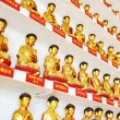 Different small golden Buddha statues inside the temple of the T — Stock Photo #69094187