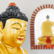 Closeup view of Golden Buddha statue in the pagoda of the Ten Th — Stock Photo #69973395