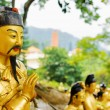 Closeup view of Golden Buddha statue on background of a red pago — Stock Photo #69973793