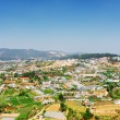 Beautiful view of the valley of agricultural lands and Da Lat ci — Stock Photo #70566451