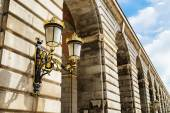 Traditional forged street lamp on a column of the Royal Palace o — Stock Photo
