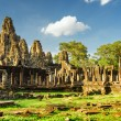 Giant stone faces of Bayon temple in Angkor Thom, Cambodia — Stock Photo #76321565