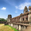 Wall of gallery and one of towers Angkor Wat temple, Cambodia — Stock Photo #78106658