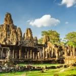 Stone faces of ancient Bayon temple. Angkor Thom, Cambodia — Stock Photo #78125658