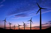 Silhouette of windmills on sunset background with space — Stock Photo