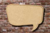 Recycle paper speech bubble on old brick wall background — Stock Photo