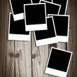 Blank instant photos on old wood background with copy space — Stock Photo #53344467