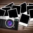 Blank photos with Classic Style Camera on old wood background — Stock Photo #63029083