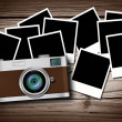 Blank instant photos on old wood background with classic camera — Stock Photo #65014003