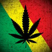 Cannabis leaf on grunge rastafarian flag. — Stock Vector