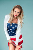 Pinup girl with american flag — Stock Photo