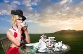 Woman at wonderland tea-party — Stock Photo
