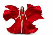 Woman in red fluttering dress — Stock Photo