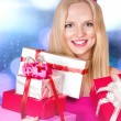 Young woman with gift boxes — Stock Photo #58233555