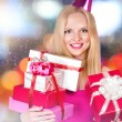 Young woman with gift boxes — Stock Photo #58855655